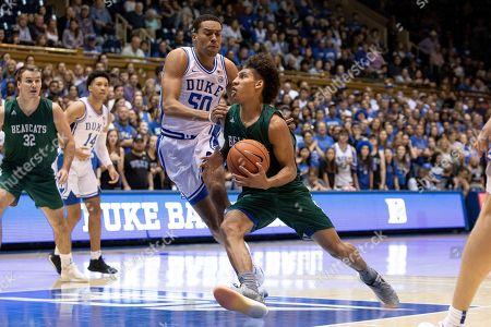 Diego Bernard, Justin Robinson. Northwest Missouri State's Diego Bernard (1) drives against Duke's Justin Robinson (50) during an NCAA college basketball game in Durham, N.C