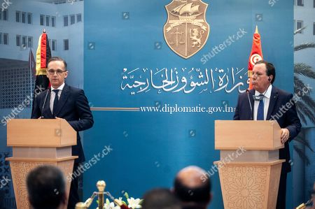 Tunisian Foreign Minister Khemaies Jhinaoui, right, and his German counterpart Heiko Maas speak to the media during a joint news conference after their meeting, in Tunis, Tunisia