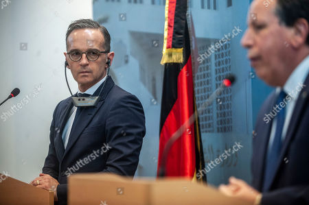 Tunisian Foreign Minister Khemaies Jhinaoui, right, speaks to the media as his German counterpart Heiko Maas listens during a joint news conference after their meeting, in Tunis, Tunisia
