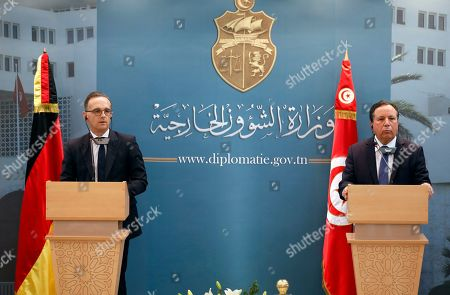 Stock Photo of German Foreign Minister Heiko Maas (L) speaks during a joint press conference with his Tunisian counterpart Khemaies Jhinaoui (R) at the headquarters of the Ministry of Foreign Affairs in Tunis, Tunisia, 28 October 2019. Maas is visiting Tunisia few days after newly-elected Tunisian President Kais Saied was sworn-in.