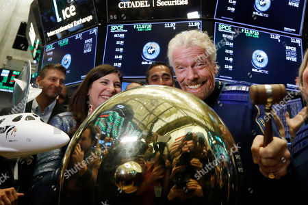 Sir Richard Branson, founder of Virgin Galactic, rings a ceremonial bell on the floor of the New York Stock Exchange, as his company's stock opens for trading