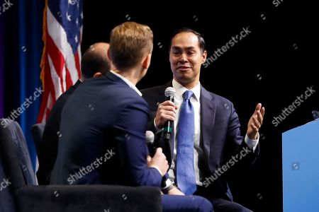 """Former Housing and Urban Development Secretary and Democratic presidential candidate Julian Castro speaks at the J Street National Conference, with the hosts of """"Pod Save the World,"""", in Washington"""