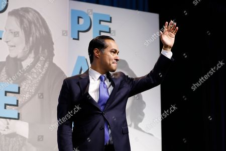 """Former Housing and Urban Development Secretary and Democratic presidential candidate Julian Castro arrives to speak at the J Street National Conference, with the hosts of """"Pod Save the World,"""", in Washington"""