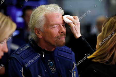Sir Richard Branson, Founder of Virgin Galactic, gets a make-up touch-up before an interview on the floor of the New York Stock Exchange