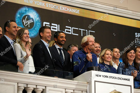 Sir Richard Branson, Founder of Virgin Galactic, holds the closing gavel of the New York Stock Exchange as he poses for photos on the bell podium,. NYSE President Stacey Cunningham is at right