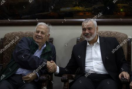 Ismail Haniyeh, Hanna Nasser. Palestinian Hamas movement chief, Ismail Haniyeh, right, shakes hands with the head of the Central Elections Commission, Hanna Nasser, during a meeting in Gaza City,. The militant Hamas group that runs the Gaza Strip says it's ready to go for Palestinian elections