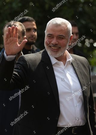 Hamas movement chief, Ismail Haniyeh, waves on his arrival to meet with the head of the Central Elections Commission, Hanna Nasser, in Gaza City,. The militant Hamas group that runs the Gaza Strip says it's ready to go for Palestinian elections