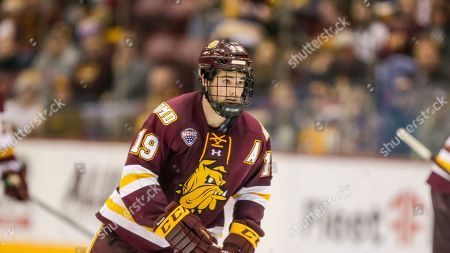 Stock Picture of Minnesota Duluth forward Justin Richards skates against Minnesota during an NCAA hockey game on in Minneapolis