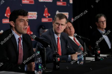 Boston Red Sox's Chaim Bloom, far left, speaks at a news conference as, from left, team president and CEO Sam Kennedy, team chairman Tom Werner and team principal owner John Henry listen, at Fenway Park in Boston. It was announced that Bloom will be the baseball team's Chief Baseball Officer and will be responsible for all matters of baseball operations