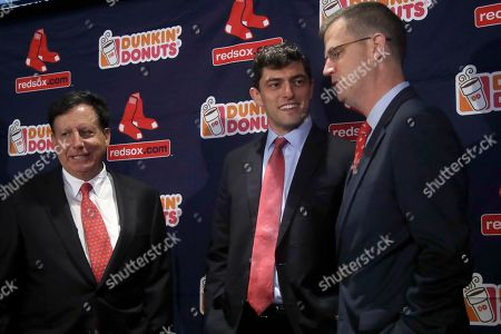 Chaim Bloom, Sam Kennedy, Tom Werner. Boston Red Sox's Chaim Bloom, middle, chats with team president and CEO Sam Kennedy, right, and team chairman Tom Werner, left, at Fenway Park in Boston. It was announced that Bloom will be the baseball team's Chief Baseball Officer and will be responsible for all matters of baseball operations