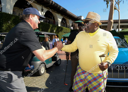 Stock Photo of Jack McGee, Cedric the Entertainer. Jack McGee, left, and Cedric the Entertainer attend the 20th Annual Emmys Golf Classic at the Wilshire Country Club, in Los Angeles