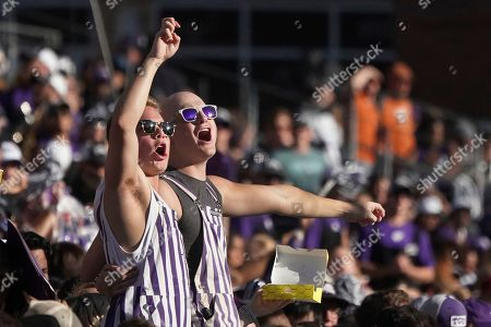 TCU fans are pictured in the stands in the second half of an NCAA college football game against Texas in Fort Worth, Texas