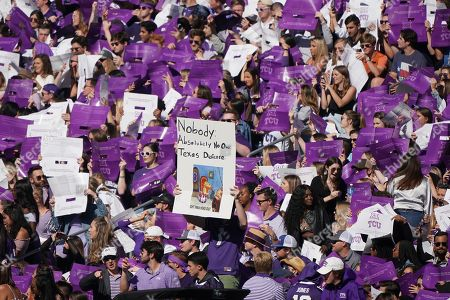 TCU fans are pictured in the first half of an NCAA college football game against Texas in Fort Worth, Texas
