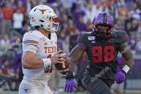 Texas quarterback Sam Ehlinger (11) is pictured in the second half of an NCAA college football game against TCU in Fort Worth, Texas