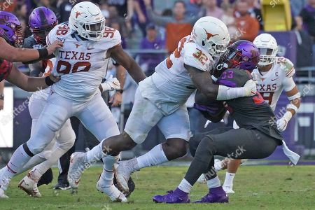 Malcolm Roach, Sewo Olonilua. Texas defensive lineman Malcolm Roach (32) tackles TCU running back Sewo Olonilua (33) in the second half of an NCAA college football game in Fort Worth, Texas