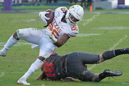 Keaontay Ingram, Ben Wilson. Texas running back Keaontay Ingram (26) runs the ball as TCU linebacker Ben Wilson (18) defends in the second half of an NCAA college football game in Fort Worth, Texas