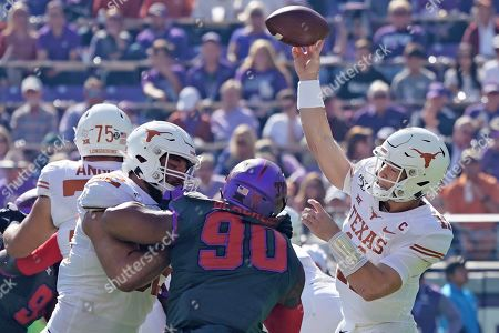 Texas quarterback Sam Ehlinger (11) throws a passin the first half of an NCAA college football game in Fort Worth, Texas