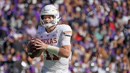 Texas quarterback Sam Ehlinger (11) is pictured in the first half of an NCAA college football game against TCU in Fort Worth, Texas