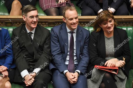 Lawmakers react during a debate on an early election, with members of the ruling Conservative Party, from left, Jacob Rees-Mogg, Dominic Raab, Nicky Morgan, in the House of Commons, London,. Lawmakers on Monday rejected Johnson's call for a December national election, in the hope of breaking the political deadlock over Brexit