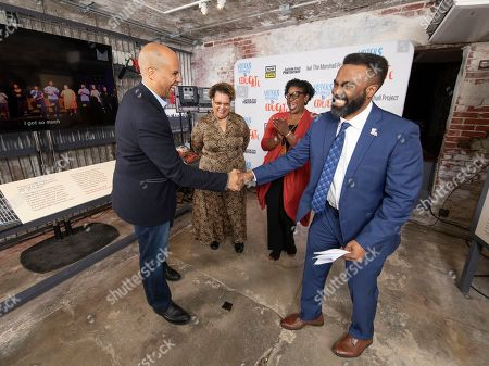 Senator Cory Booker (D-NJ), left, greets Daryl Atkinson, Voters Organized to Educate advisory board member as Rev. Vivian Nixon, second from left, and DeAnna Hoskins look on during Justice Votes 2020, a presidential town hall, at Eastern State Penitentiary Historic Site in Philadelphia, PA