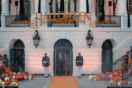 Donald Trump, Melania Trump. President Donald Trump and first lady Melania Trump arrive to give candy to children during a Halloween trick-or-treat event on the South Lawn of the White House which is decorated for Halloween, in Washington