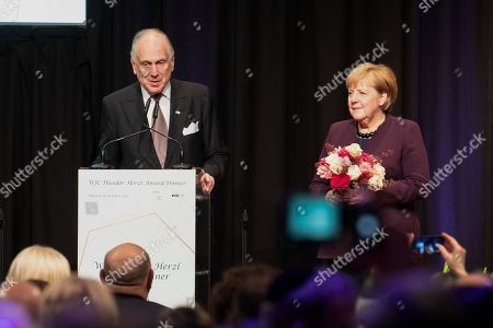 Ronald Lauder, president of the Jewish World Congress and Angela Merkel (CDU).  Angela Merkel was awarded with the Theodor-Herzl-Award by the Jewish World Congress in the Hubert-Burda-Saa. She got this prize for her commitment for Jewish life in Israel and Germany.