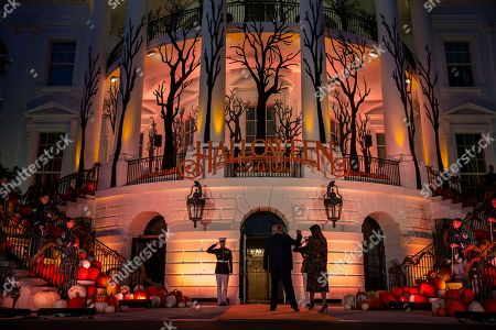Donald Trump, Melania Trump. President Donald Trump and first lady Melania Trump depart after giving candy to children during a Halloween trick-or-treat event on the South Lawn of the White House which is decorated for Halloween, in Washington