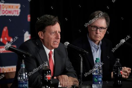Boston Red Sox baseball team chairman Tom Werner, left, speaks as principal owner John Henry listens at a news conference at Fenway Park, in Boston