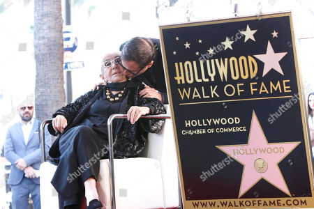 David O. Russell kisses Italian filmmaker Lina Wertmuller during her Hollywood Walk of Fame star ceremony in Hollywood, Los Angeles, California, USA 28 October 2019. Lina Wetmuller received the 2,679th star on the Hollywood Walk of Fame in the category of Motion Pictures.