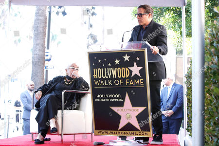 David O. Russell speaks as Italian filmmaker Lina Wertmuller looks on during her Hollywood Walk of Fame star ceremony in Hollywood, Los Angeles, California, USA 28 October 2019. Lina Wetmuller received the 2,679th star on the Hollywood Walk of Fame in the category of Motion Pictures.