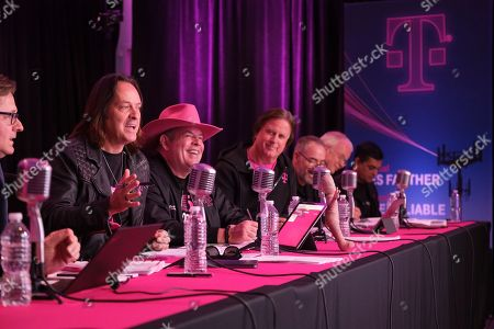IMAGE DISTRIBUTED FOR T-MOBILE - T-Mobile executives including CEO John Legere, second from left, and CFO Braxton Carter, third from left, report out on another record-breaking quarter during the T-Mobile Q3 2019 Earnings Call on in Bellevue, Wash. Results included record service revenues of $8.6 billion and record low Q3 branded phone churn of .89 percent. Executives also discussed the company's aggressive deployment of 600Mhz spectrum - setting the stage for the launch of the first nationwide 5G in 2019