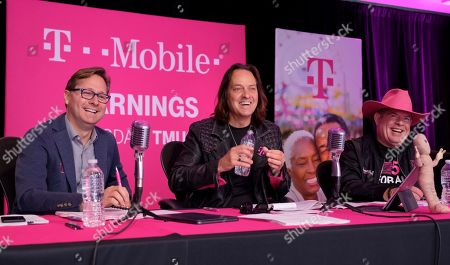 Stock Picture of T-Mobile CEO John Legere, center, along with President Mike Sievert, left, and CFO Braxton Carter report record financials during the T-Mobile Q3 2019 Earnings Call on in Bellevue, Wash. America's Un-carrier reported record high service revenues and record third-quarter financial results including net income, adjusted EBITDA, net cash provided by operating activities and free cash flow