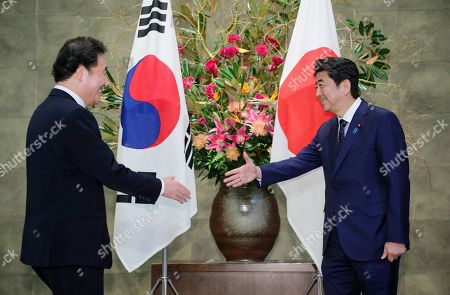 Stock Photo of South Korean Prime Minister Lee Nak-yeon (L) shakes hands with Japanese Prime Minister Shinzo Abe (R) prior to their meeting at Abe's official residen?ce in Tokyo, Japan, 24 October 2019.