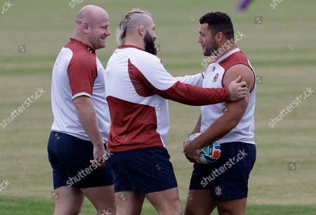 England's Joe Marler, centre, jokes with teammate Ellis Gene, right, as Dan Cole watches during a training session in Tokyo, Japan, . England will play South Africa in the Rugby World Cup final on Saturday Nov. 2. in Yokohama