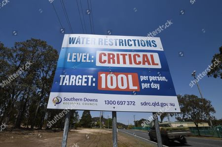 Stock Photo of A billboard indicates critical water levels near Stanthorpe, Queensland, Australia, 16 October 2019 (issued 29 October 2019). The town of Stanthorpe has been struggling with severe drought and consequential bushfires since September 2019. With the dam's water level down to 25 percent, the town faces an imminent water shortage. Queensland Premier Annastacia Palaszczuk announced in September 2019 a plan to truck in 1.6 million liters of water from a nearby dam to the Storm King Dam, as Stanthorpe is predicted to run out of water by Christmas.