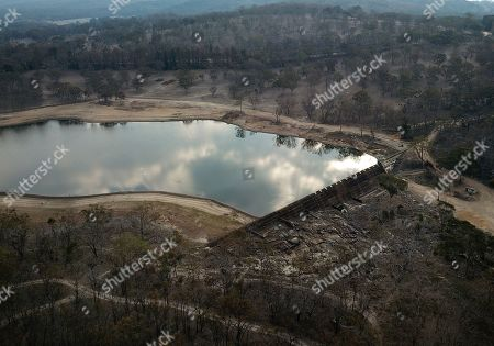 An aerial view of the Storm King Dam near Stanthorpe, Queensland, Australia, 10 October 2019 (issued 29 October 2019). The town of Stanthorpe has been struggling with severe drought and consequential bushfires since September 2019. With the dam's water level down to 25 percent, the town faces an imminent water shortage. Queensland Premier Annastacia Palaszczuk announced in September 2019 a plan to truck in 1.6 million liters of water from a nearby dam to the Storm King Dam, as Stanthorpe is predicted to run out of water by Christmas.