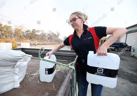 A woman collects water donated by a local charity group in Stanthorpe, Queensland, Australia, 09 October 2019 (issued 29 October 2019). The town of Stanthorpe has been struggling with severe drought and consequential bushfires since September 2019. With the dam's water level down to 25 percent, the town faces an imminent water shortage. Queensland Premier Annastacia Palaszczuk announced in September 2019 a plan to truck in 1.6 million liters of water from a nearby dam to the Storm King Dam, as Stanthorpe is predicted to run out of water by Christmas.