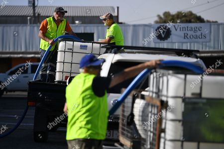 Volunteers from Granite Belt Water Relief charity group fill up client's water tanks in Stanthorpe, Queensland, Australia, 09 October 2019 (issued 29 October 2019). The town of Stanthorpe has been struggling with severe drought and consequential bushfires since September 2019. With the dam's water level down to 25 percent, the town faces an imminent water shortage. Queensland Premier Annastacia Palaszczuk announced in September 2019 a plan to truck in 1.6 million liters of water from a nearby dam to the Storm King Dam, as Stanthorpe is predicted to run out of water by Christmas.