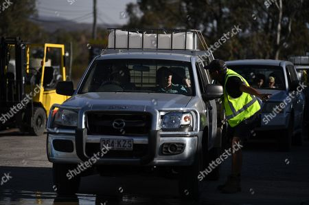 Local residents wait to collect water donated by a local charity group in Stanthorpe, Queensland, Australia, 09 October 2019 (issued 29 October 2019). The town of Stanthorpe has been struggling with severe drought and consequential bushfires since September 2019. With the dam's water level down to 25 percent, the town faces an imminent water shortage. Queensland Premier Annastacia Palaszczuk announced in September 2019 a plan to truck in 1.6 million liters of water from a nearby dam to the Storm King Dam, as Stanthorpe is predicted to run out of water by Christmas.