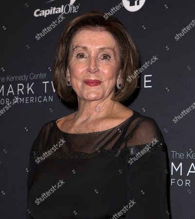 Nancy Pelosi arrives at the Kennedy Center for the Performing Arts for the 22nd Annual Mark Twain Prize for American Humor presented to Dave Chappelle, in Washington, D.C