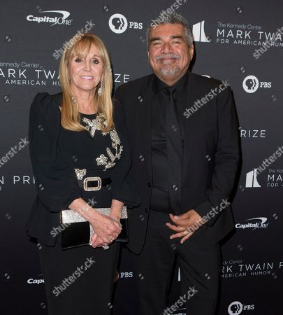 Iris Smith, George Lopez. Iris Smith, left, and George Lopez arrive at the Kennedy Center for the Performing Arts for the 22nd Annual Mark Twain Prize for American Humor presented to Dave Chappelle, in Washington, D.C