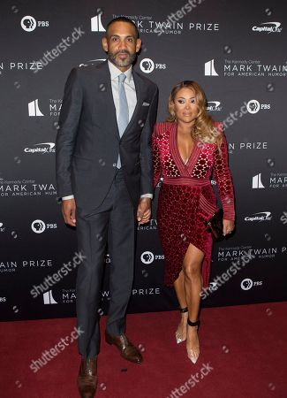 Grant Hill, Tamia Hill. Grant Hill, left with his wife Tamia Hill arrive at the Kennedy Center for the Performing Arts for the 22nd Annual Mark Twain Prize for American Humor presented to Dave Chappelle, in Washington, D.C