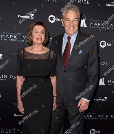 Nancy Pelosi, Paul Pelosi. Nancy Pelosi, left, with her husband Paul Pelosi arrive at the Kennedy Center for the Performing Arts for the 22nd Annual Mark Twain Prize for American Humor presented to Dave Chappelle, in Washington, D.C