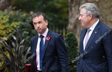 Alun Cairns, Secretary of State for Wales, and Brandon Lewis, Minister of State for the Home Office, arrive at No.10 Downing Street, London.