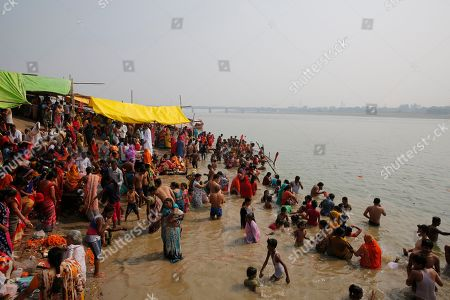 Hindu devotees take holy dip in River Yamuna during Bhai Dooj festival in Prayagraj, India, . Bhai Dooj is a festival celebrated by Hindus in north India where sisters mark their love to their brothers by performing rituals which they believe will protect them from evil forces