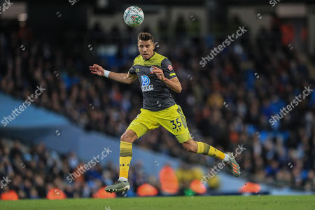 29th October 2019, Etihad Stadium, Manchester, England; Carabao Cup, Manchester City v Southampton : Jan Bednarek (35) of Southampton heads the ball 