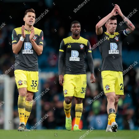 Southampton players including Jan Bednarek left applaud supporters after the game