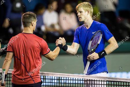 Stock Picture of Kyle Edmund (R) of Great Britain shakes hand with Ricardas Berankis (L) of Lituania after winning their match at the Rolex Paris Masters tennis tournament in Paris, France, 29 October 2019.