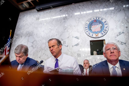 John Thune, Roy Blunt, Roger Wicker. Sen. John Thune, R-S.D., center, accompanied by Sen. Roy Blunt, R-Mo., left, and Chairman Roger Wicker, R-Miss., right, questions Boeing Company President and Chief Executive Officer Dennis Muilenburg as he appears before a Senate Transportation Committee hearing on 'Aviation Safety and the Future of Boeing's 737 MAX' on Capitol Hill in Washington