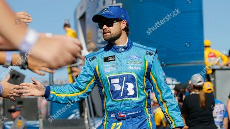 Ricky Stenhouse Jr. greets fans during the NASCAR Cup Series race at Martinsville Speedway in Martinsville, Va
